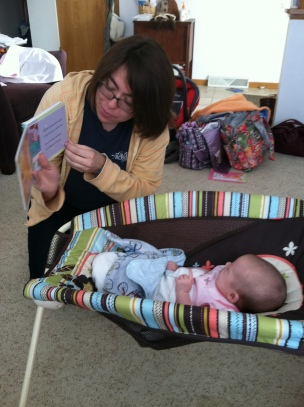 Paige [the baby whisperer] reads to baby Harper.