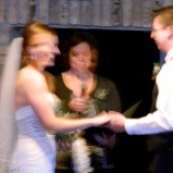 "It's blurry. But I still wanted to share. The couple smiled and laughed the whole way through. [Especially when I accidentally said ""her"" instead of ""him"" and Domanic couldn't get the rings off the knot that somehow appeared.]"