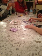Coloring and playing cards: multi-tasking at Christmas.